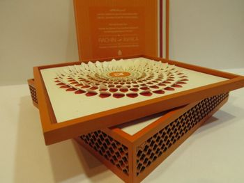Photo of cream and brown box with laser cut
