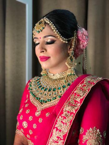 A bride in hot pink lehenga