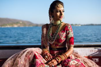 Photo of Bride wearing Sabyasachi floral lehenga.