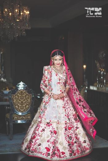 Bride wearing a multi-coloured lehenga.
