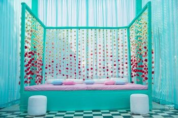 A stunning modern decor idea for your mehndi with a touch of turquoise to it.