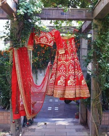 Bright Red Lehenga with Mirror Work on a Hanger