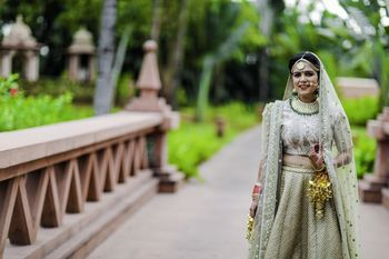 Photo of Offbeat bridal lehenga in dirty green colour