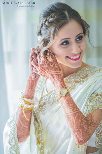 Bride in White and Gold Beaded Engagement Sari