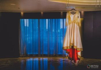 Photo of Cream and Gold Anarkali on a Hanger