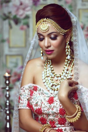 Photo of Smokey eyes with off shoulder lehenga