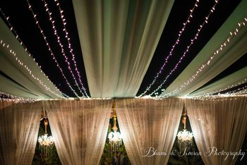 Photo of blush pink and mint green fairy lit drape decor