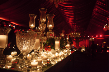 Photo of Dimly lit cocktail decor with candelabaras