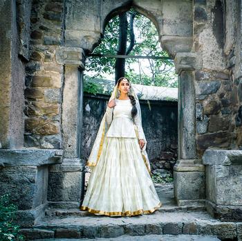 White peplum lehenga for minimal bride