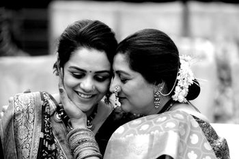 A cute candid shot of a bride with her mother.