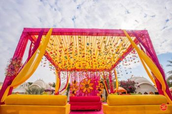 Pink and yellow mehendi decor theme with hangings