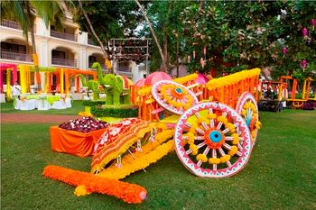 Pretty decorated bullock cart with flowers as a mehendi photo booth