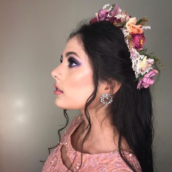 Subtle makeup with purple smoky eyeS and flowers in hair is the best combination.