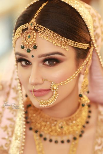 A beautiful bride on her wedding day in stunning gold jewellery.