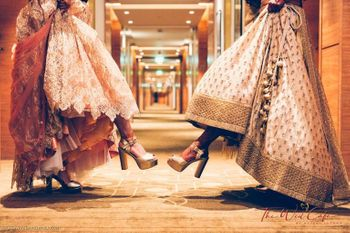 Cute bride with sister photo showing off heels