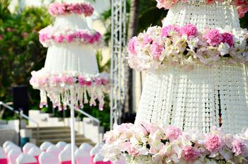 Photo of White and light pink decorated parasols in decor