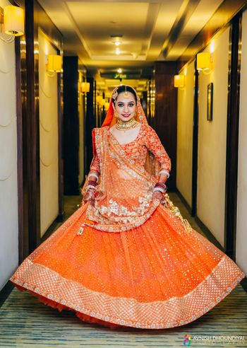 Orange and Gold Shimmer Twirling Lehenga