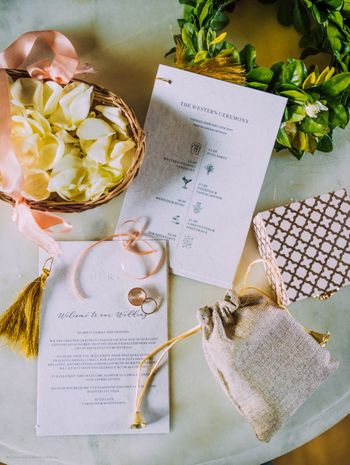 A simple wedding invite in white and gold