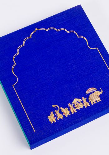 Photo of embossed elephant motif with gold embossing