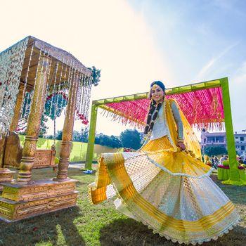 Photo of Happy twirling bride yellow lehenga