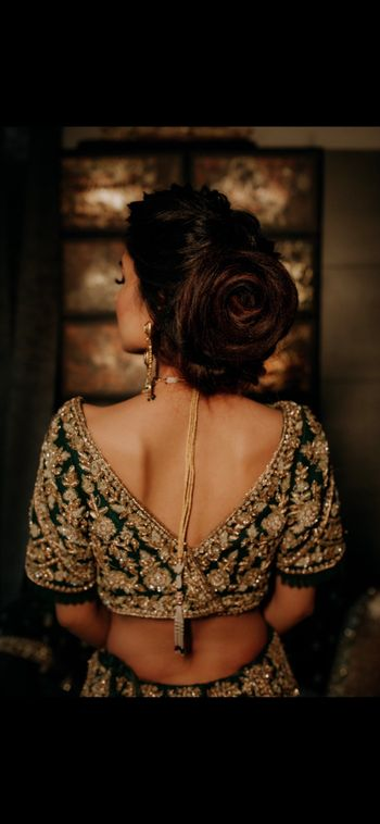 Stunning dark green blouse with gold work.