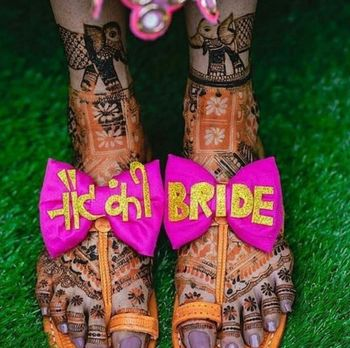 A bride flaunting her quirky footwear on her mehndi