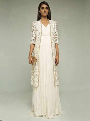 Photo of lace white and gold embellished jacket with white gown