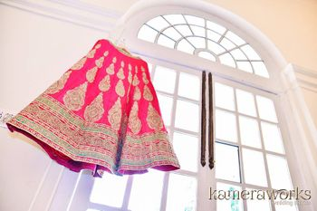 Fuchsia Pink and Mint Blue Bridal Lehenga on a Hanger