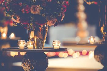 Floral Table Decor with Dim Glass Candles