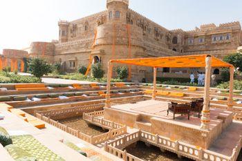 Photo of Palace Wedding Venue Outdoor Orange Mandap and Seating