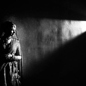 Black and white bridal portrait with light