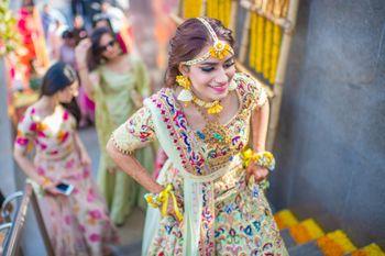 Mehendi bridal look with floral jewellery and threadwork lehenga