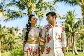 Photo of Mehendi couple portrait twinning in florals