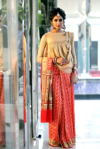 Photo of Unique blouse with draped design and orange saree