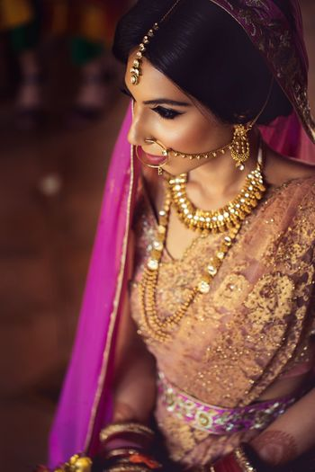 Photo of Simple bridal jewellery with Nath and maangtikka