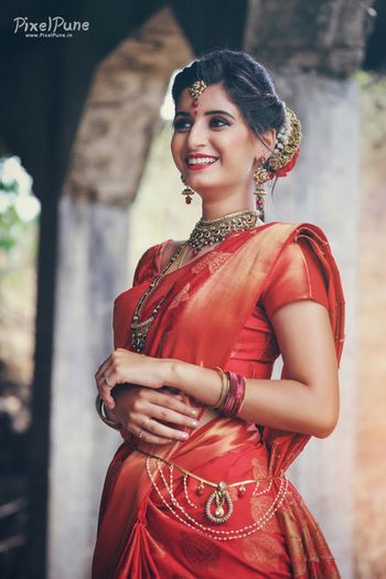orange and red bridal saree for south indian bride