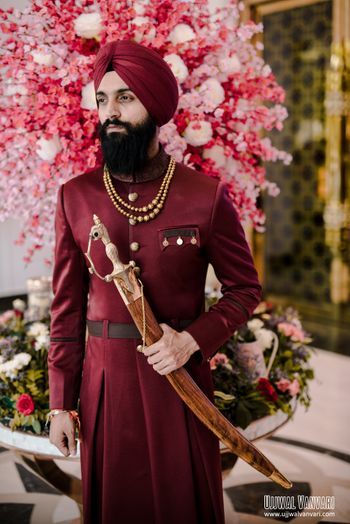 Photo of unique sherwani in maroon color