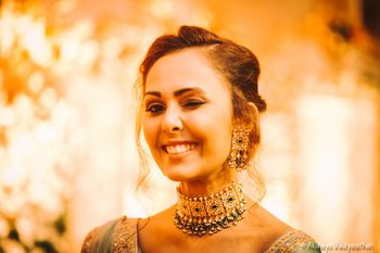 Bride wearing choker necklace on sangeet
