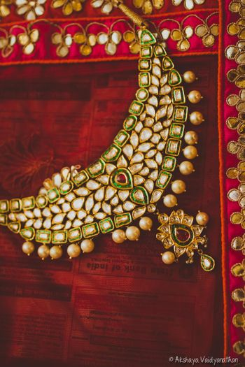 Kundan necklace with red and white beads