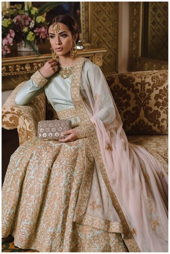 Photo of mint blue and gold floor length anarkali
