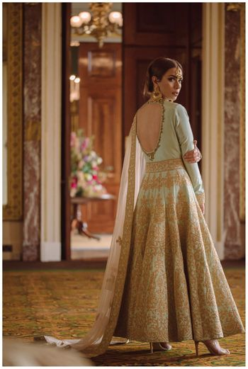 Photo of mint blue and gold anarkali