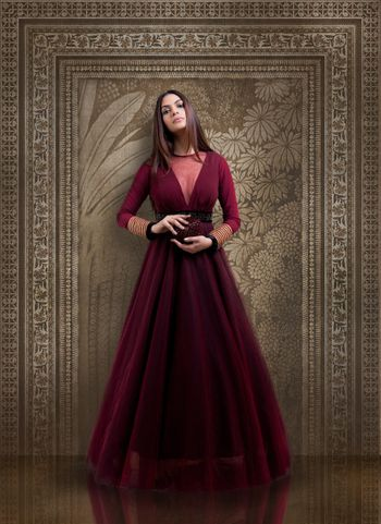 Wine Colour Gown with Sheer Neck and Full Sleeves