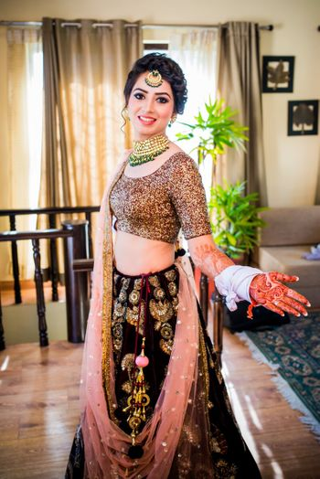Bride in maroon and gold lehenga