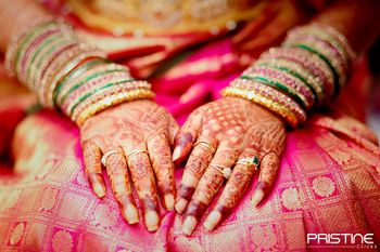 Traditional Mehendi design on hands with Bangles