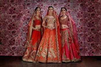 Photo of Red bridal lehengas on models