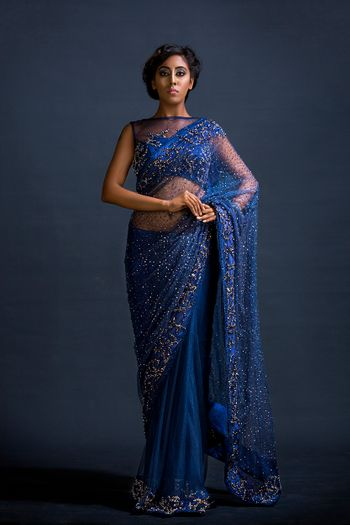 Navy blue saree with tiny gold motifs