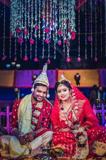 A happy bengali couple on their wedding day.