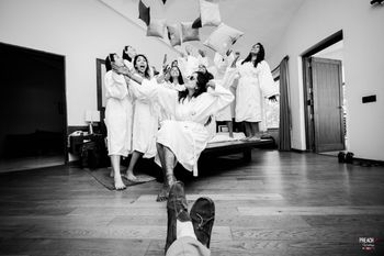Bride with Bridesmaids in Pillow Fight
