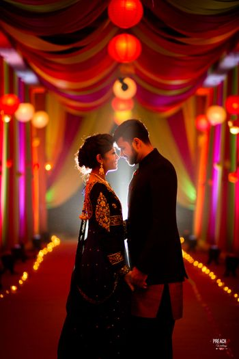 Romantic Portrait of Couple in Black at Entrance