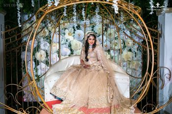 Monotone bride in gold bridal lehenga